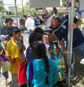 Kids lined up to answer trivia questions from our Wheel of Change with Air Pollution Control District Director, Dave.