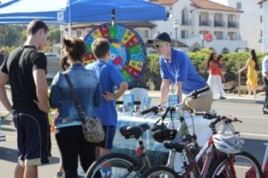 Air Pollution Control District Public Outreach Intern Chris Hewes asks some trivia questions to bikers taking a break!