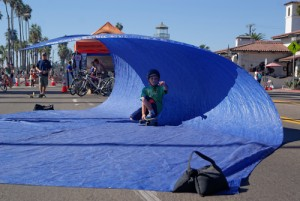 Kids get to skate through some surf on the street!